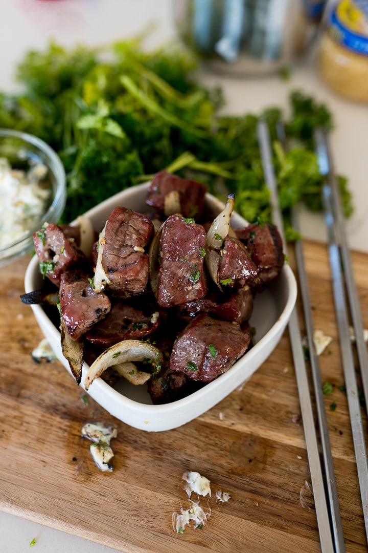 Steak kabobs in a bowl, ready to serve