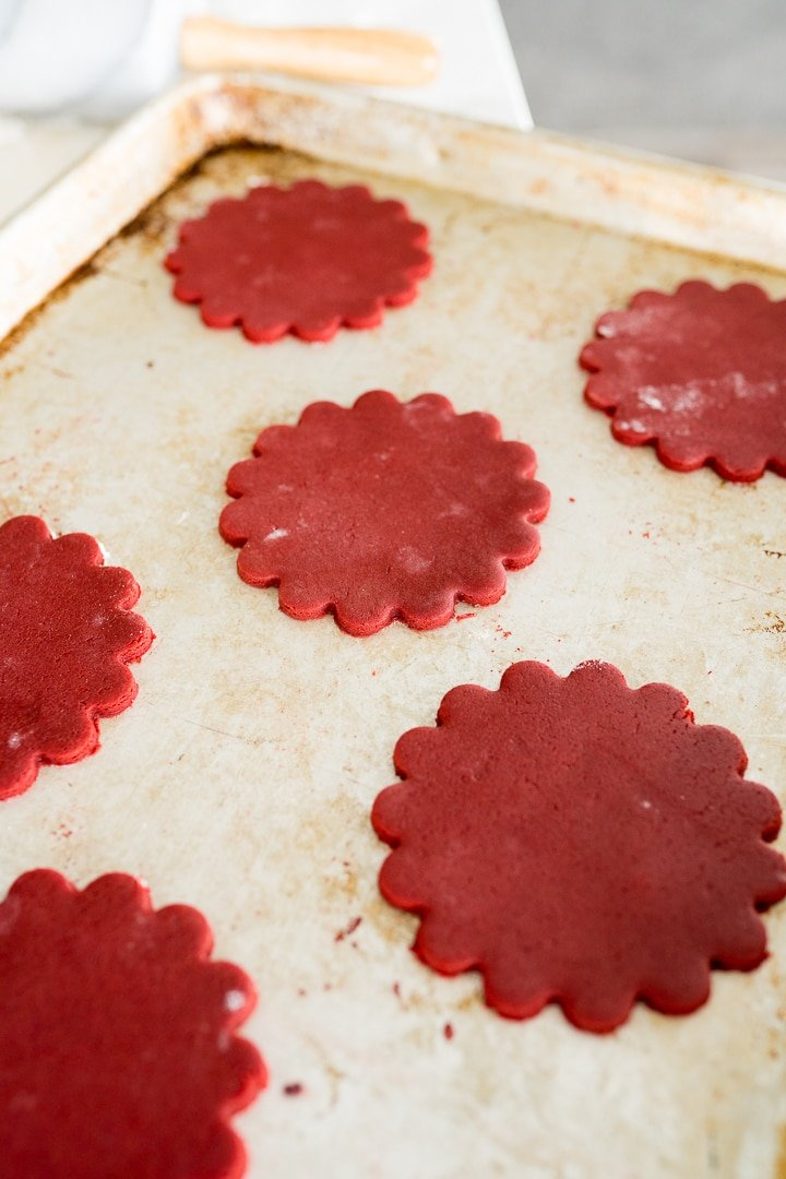 red velvet cookies cut out and on the pan before baking