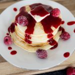 raspberry syrup on a stack of pancakes