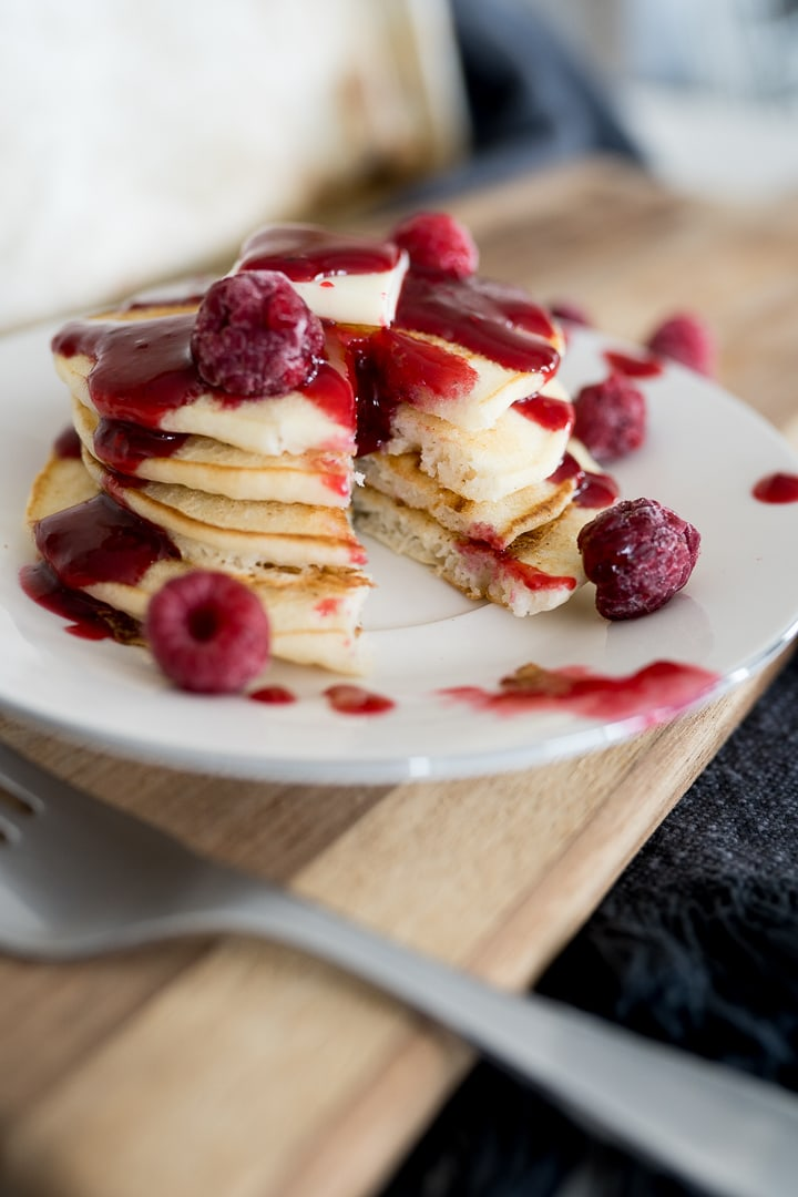 pancakes cut with raspberry syrup