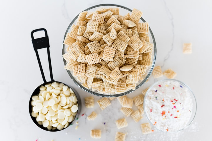Chex cereal, white chocolate chips, powdered sugar and funfetti cake mix