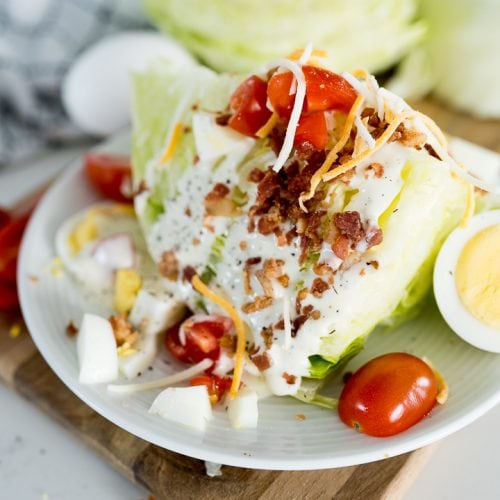 wedge salad, plated and topped with toppings