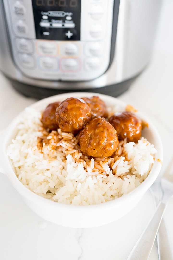 meatballs with sauce over rice