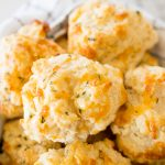 cheddar bay biscuits, in a large bowl being served