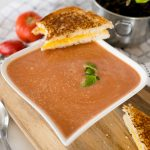 tomato basil soup with a grilled cheese sandwich