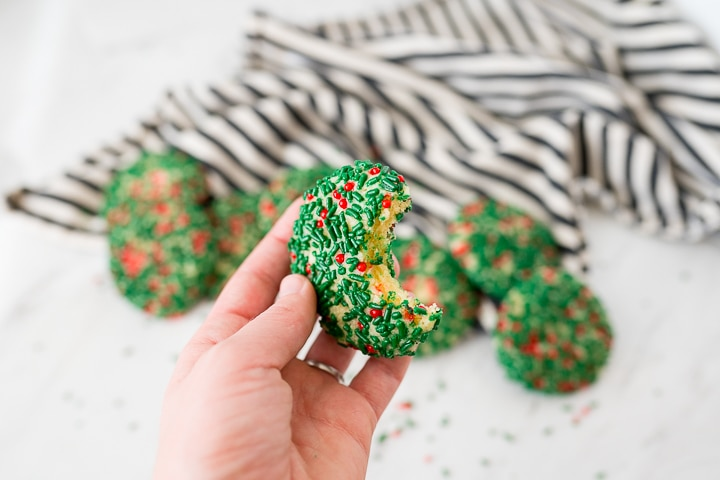 vanilla sprinkle Christmas cookie with a bite taken out