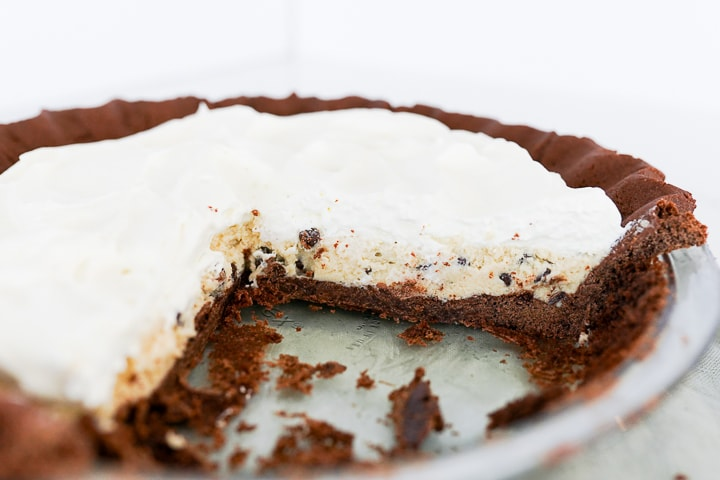 chocolate crust with cookie dough filling and whipped cream on top