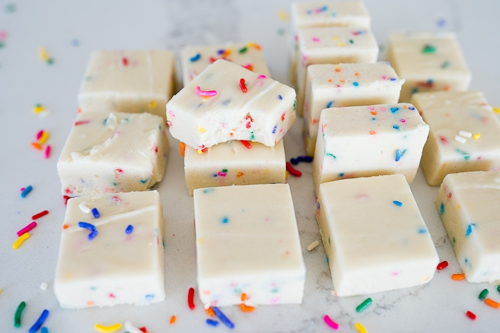 white chocolate Funfetti fudge cut into squares and lined up.