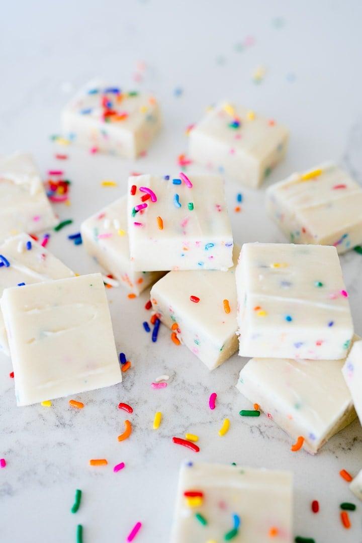 Funfetti fudge squares stacked into a pile