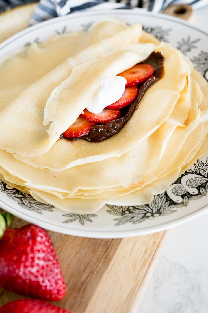 crepes with chocolate and strawberries inside