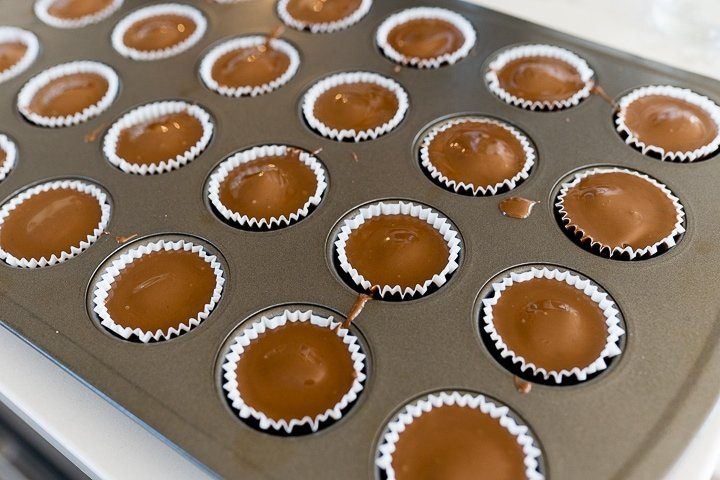 chocolate and peanut butter cups in a mini muffin pan