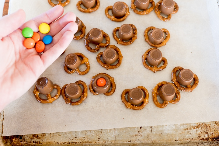 adding the m&m's on top of the melted rolos