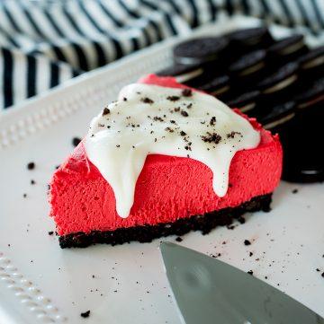 red velvet cheesecake slice with cream cheese glaze