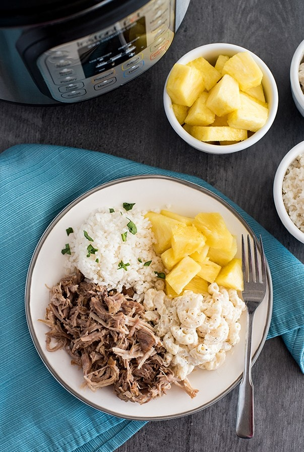 Pressure cooker kalua pulled pork on a plate with rice and pineapple