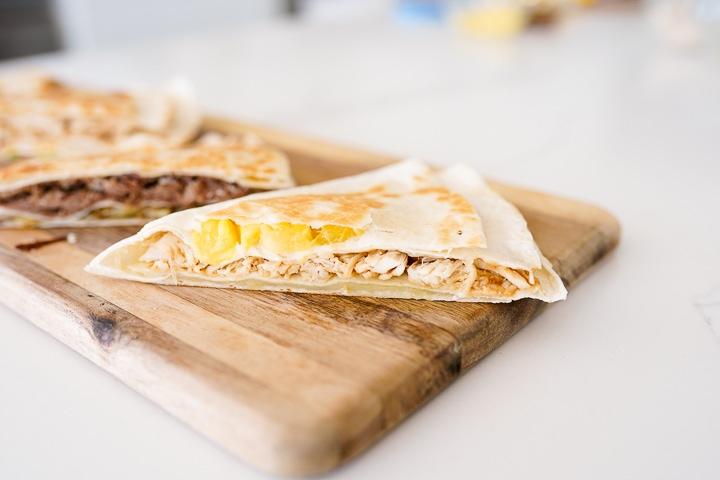 teriyaki chicken, cheese, pineapple in a folded tortilla