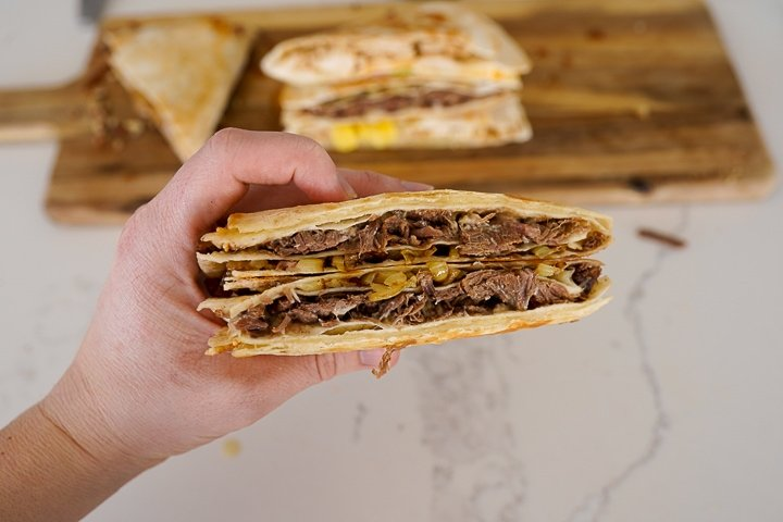 Tortilla filled with roast beef, onions and cheese