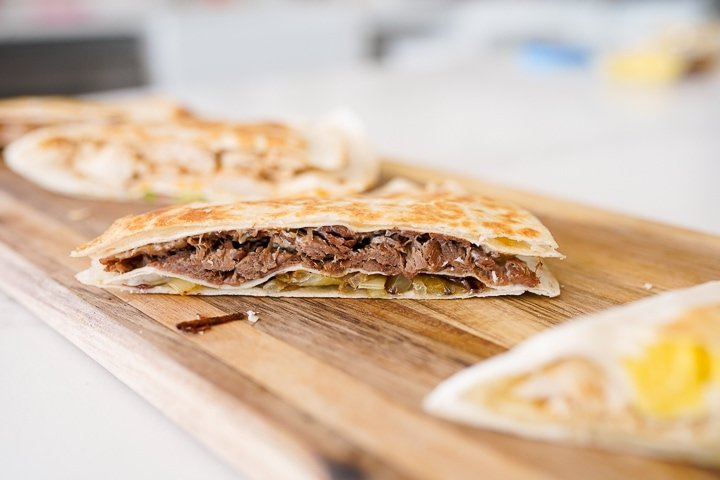 French dip tortilla fold with onions, shredded beef and cheese