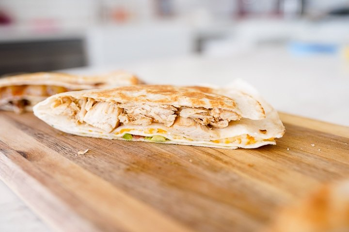 honey lime chicken, cheese, guacamole, and sour cream In a tortilla fold