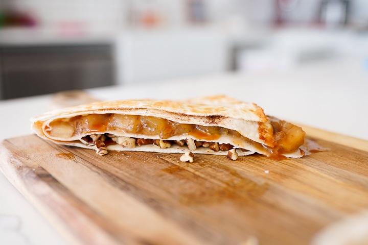 apple pie filling inside of a tortilla