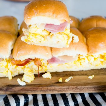 breakfast slider sandwiches with scrambled eggs, cheese and meat