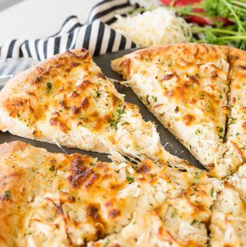 chicken alfredo flavored pizza, sliced