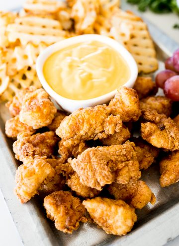 Chick fil a nuggets on a tray with waffle fries