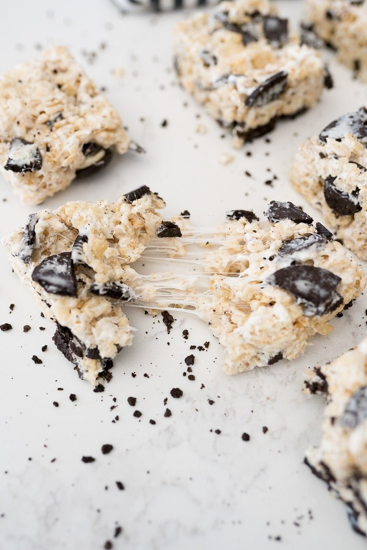 Rice Krispie treat with Oreos being pulled apart with marshmallows stretching