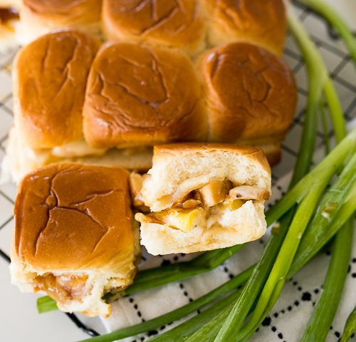 Teriyaki Chicken Sandwiches on a black cooling rack with green onions