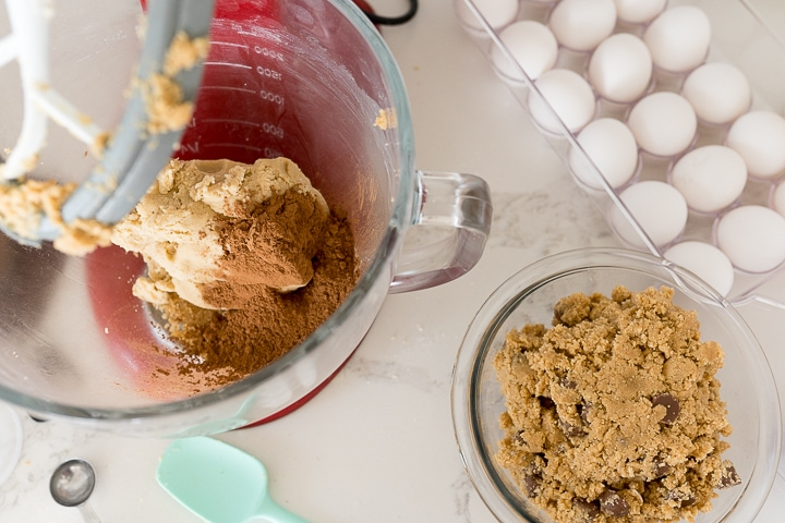 cocoa powder being added to the other half of the cookie dough in the stand mixer.