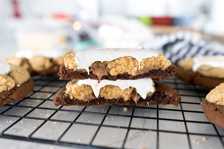 cookie broken in half, stacked on top of each other with chocolate and marshmallow oozing.