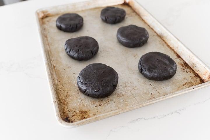 Oreo cookie dough balls on pan before baking