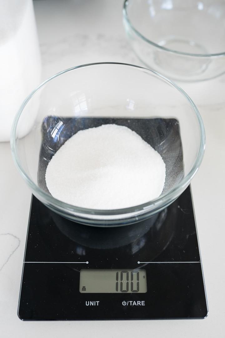 granulated sugar being weighed
