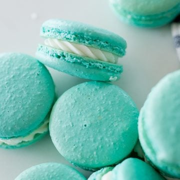blue macarons with white filling, on a white background