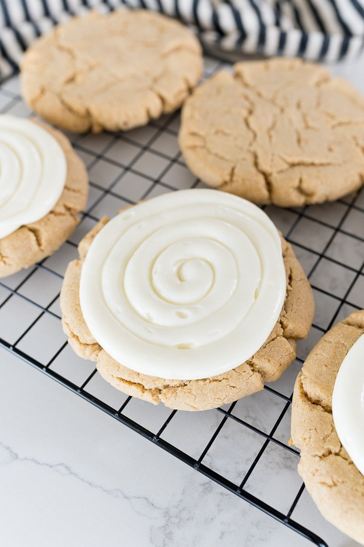 graham cracker cookies with a cheesecake frosting swirl