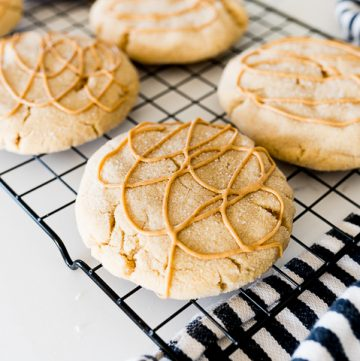 Crumbl Ultimate Peanut Butter Cookies on a cooling rack