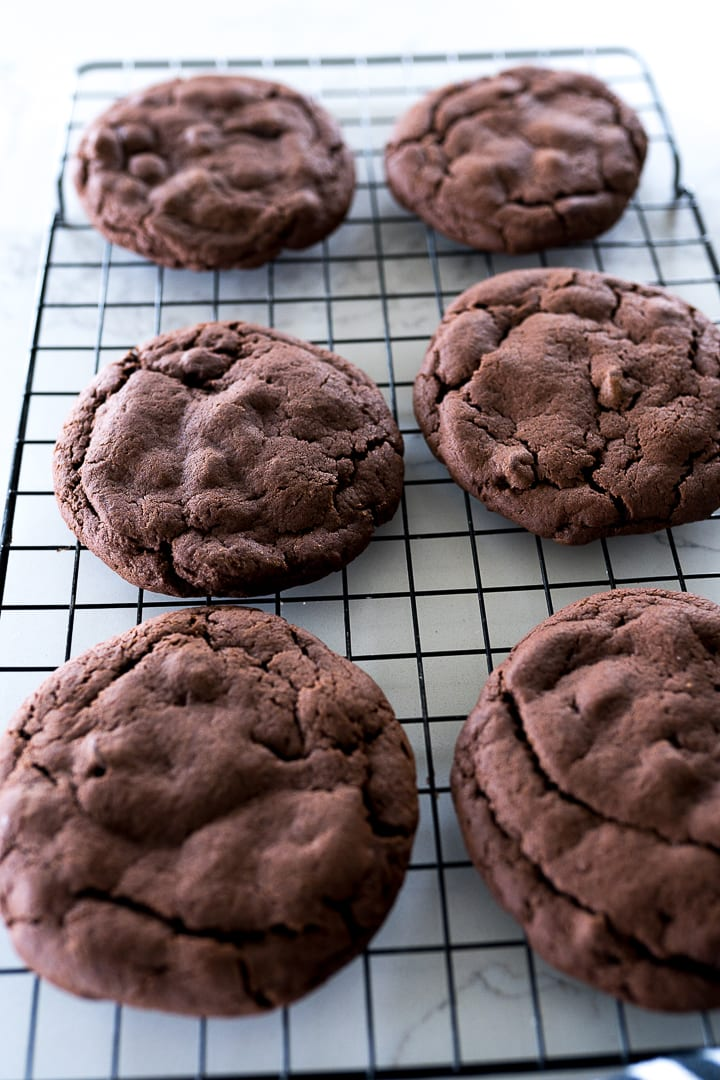 Chocolate cookies on a cookie cooling rack