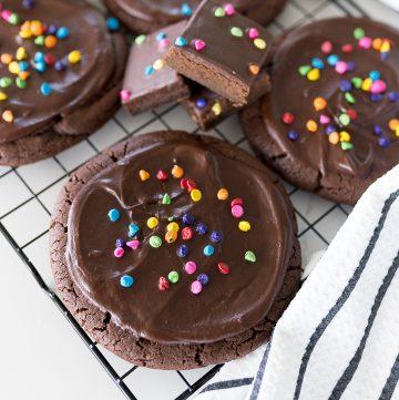 cosmic brownie cookies on a black cookie cooling rack