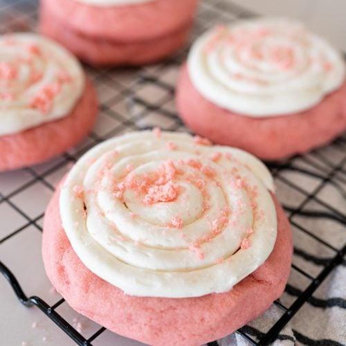 pink velvet cookies on a cookie cooling rack